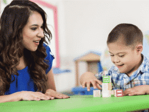 Boy-with-Down-syndrome-and-aide_tutor-e1569528252898-300x225.png