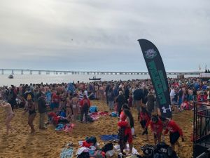 Sandy Hook Point beach full of polar bear plunge participants