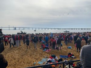 Polar bear plungers mingle on Sandy Hook Point Beach